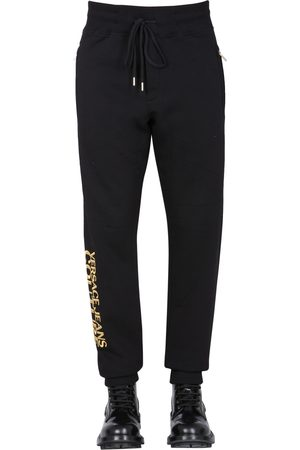 VERSACE Jogging pants with embroidered logo