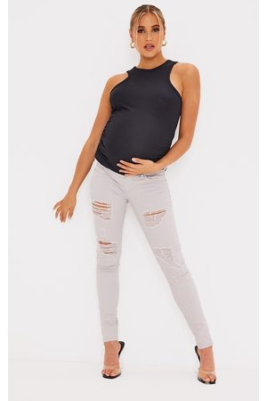 PRETTYLITTLETHING Maternity Stone Ripped Skinny Jeans