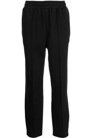 Fila Men Sweatpants - Donning double-knit track pants