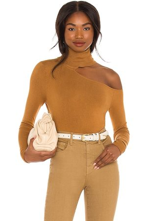 L'Agence Nicky Cut Out Turtleneck Sweater in Burnt Orange.