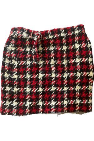 Alexander McQueen Tweed mini skirt