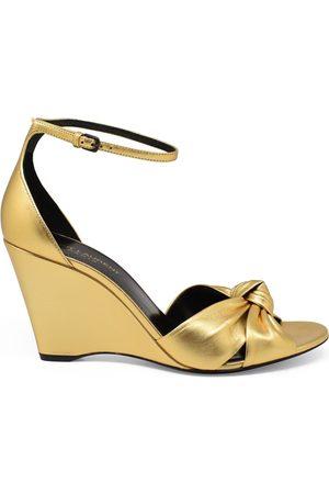 Saint Laurent Luxury shoes for women - Bianca in gold leather sandals low heel