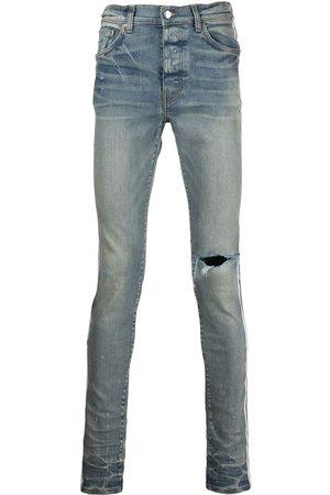 AMIRI Men Slim - Distressed-effect side-stripe jeans