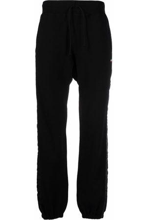 UNDERCOVER Men Wide Leg Pants - Tonal-trim wide leg trackpants