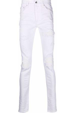 AMIRI Ripped-detail denim jeans