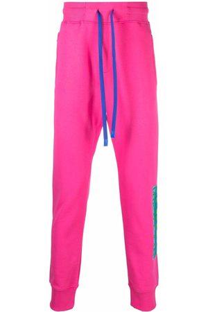VERSACE Log-print cotton track trousers