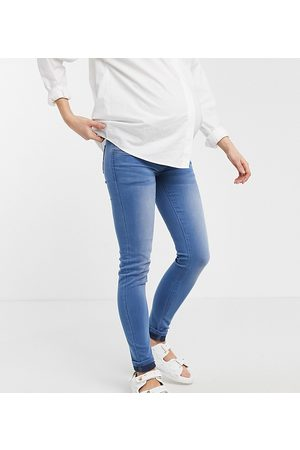 Mama.licious Women Skinny - Mamalicious Maternity over the bump skinny jeans in blue-Blues