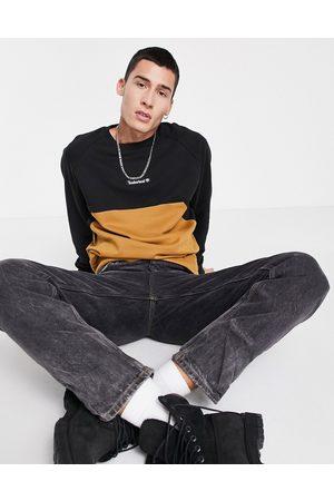 Timberland Cut & Sew crew neck sweatshirt in wheat tan/black