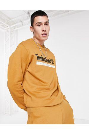 Timberland Established 1973 crew neck sweatshirt in wheat tan