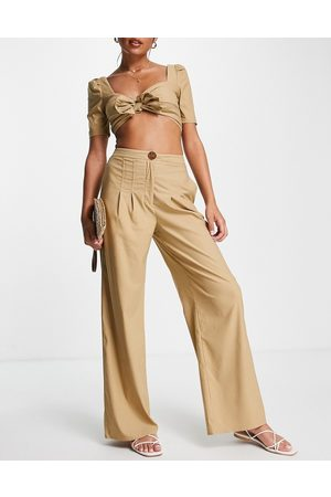Skylar Rose 2 piece wide leg pant and bow front crop top set in tan