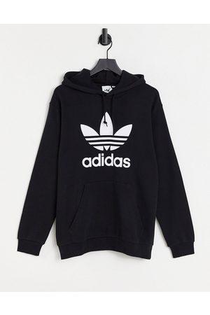 adidas Originals Adicolor large trefoil hoodie in black-Navy