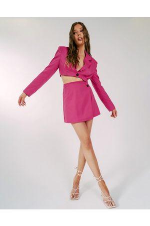 Aria Cove Women Mini Skirts - Asymmetric button detail wrap mini skirt set in hot