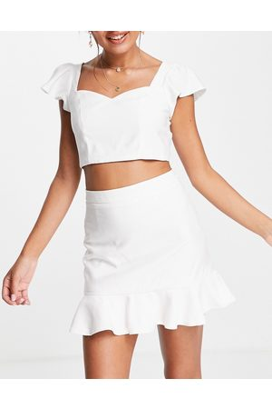 Skylar Rose 2 piece crop top and pephem mini skirt set in off