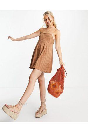 Skylar Rose Gingham babydoll mini dress in tan