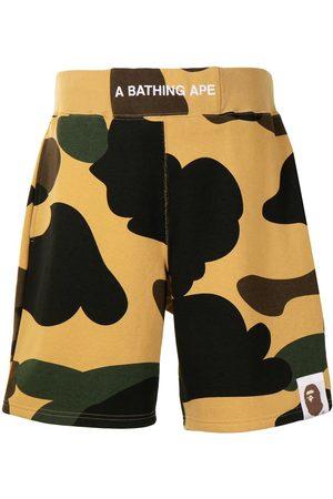 A Bathing Ape Camo-print logo waistband shorts