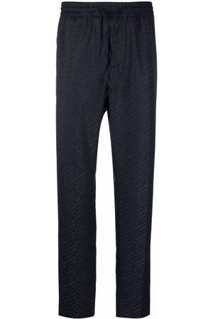 VERSACE Greca-print trousers
