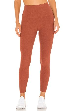 Beyond Yoga Spacedye Caught in the Midi High Waisted Legging in Rust.