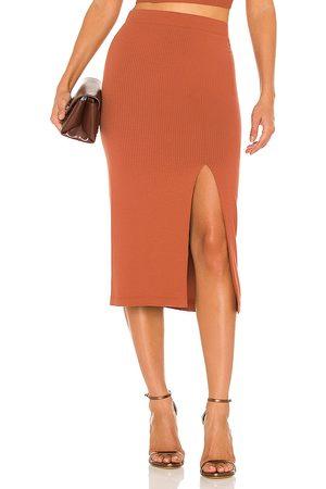 krisa Women Midi Skirts - X REVOLVE Bodycon Slit Skirt in Burnt Orange.