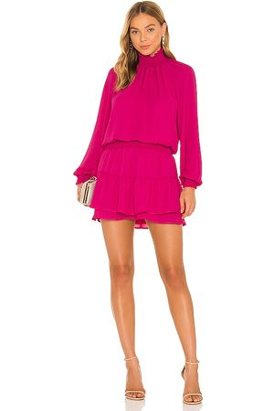 krisa Turtleneck Ruffle Skirt Dress in Fuchsia.