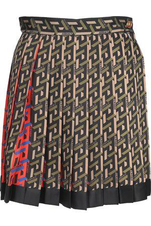 Versace Women Printed Skirts - La Greca print pleated mini skirt