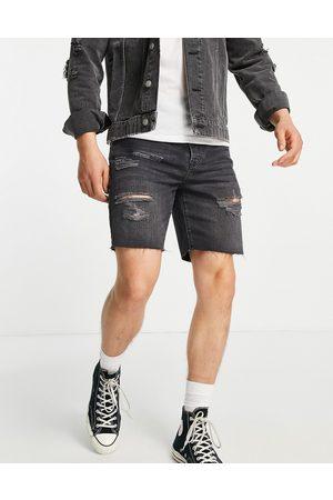 Topman Ripped slim denim shorts in washed