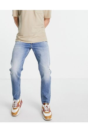 ASOS Stretch tapered jeans in vintage mid wash with rips-Blues