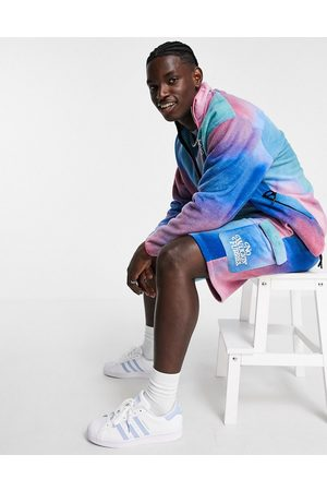 ASOS Oversized polar fleece shorts in abstract print with embroidery - part of a set-Multi