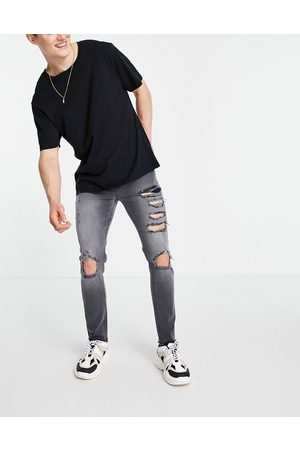 ASOS Skinny jeans with heavy rips and raw hem in washed
