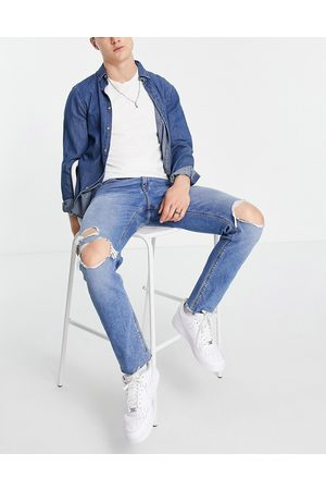 ASOS Slim jeans with knee rips and raw hem in mid wash blue-Blues