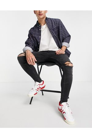 ASOS Spray-on jeans with power stretch in washed with knee rips