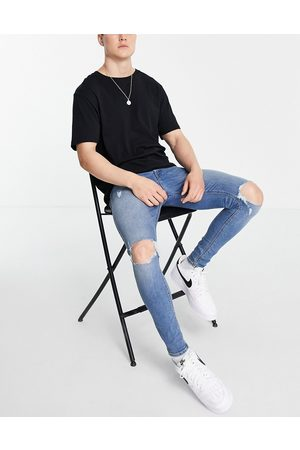 ASOS Spray on jeans with power stretch in vintage mid wash with knee rips-Blues