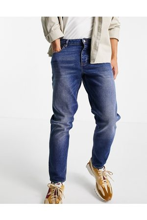 ASOS Stretch tapered jeans in vintage blue wash-Blues