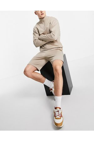 ASOS Lightweight tracksuit with oversized half zip sweatshirt and slim shorts in -Neutral