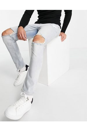 ASOS Stretch slim jeans in vintage light wash with knee rips-Blues