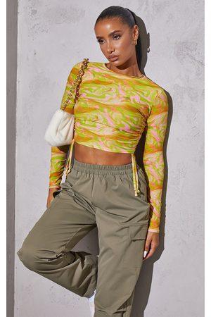 PRETTYLITTLETHING Women Crop Tops - Swirl Jersey Tie Ruched Side Long Sleeve Crop Top