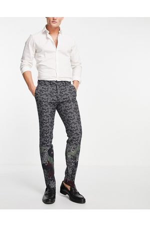 Twisted Tailor Suit pants in navy jacquard with crane and floral border detail