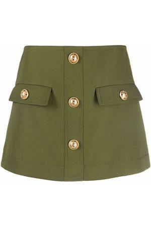 Balmain Women Mini Skirts - Logo-button mini A-line skirt