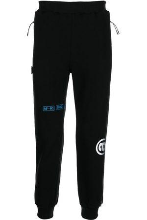 AAPE BY A BATHING APE Men Sweatpants - Graphic-print track pants