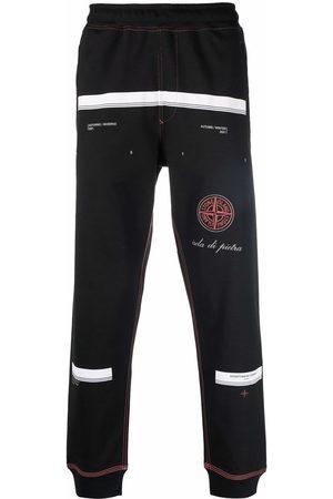Stone Island Men Sweatpants - Compass motif slogan-print track pants