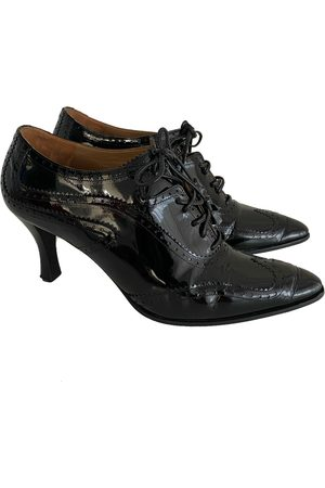 Hermès Patent leather lace up boots