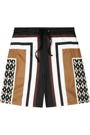 VALENTINO Men Shorts - Printed jersey shorts