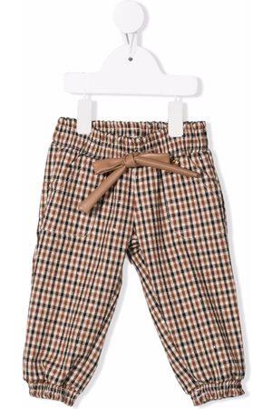 MISS BLUMARINE Chinos - Plaid-check print trousers