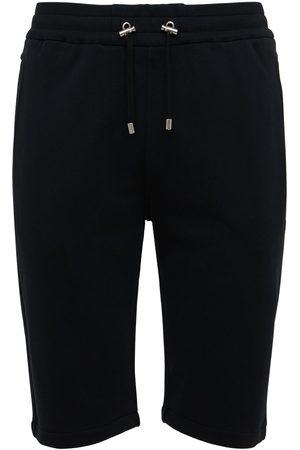 Balmain Men Shorts - Flocked Logo Organic Cotton Sweat Shorts