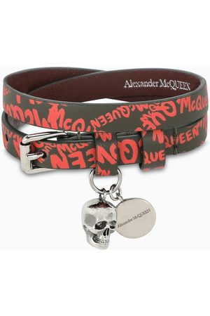 Alexander McQueen Black logoed bracelet with skull pendant