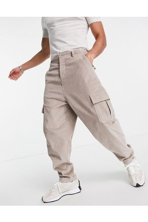 ASOS Men Cargo Pants - Oversized tapered fit pants with cargo pockets in cord-Neutral