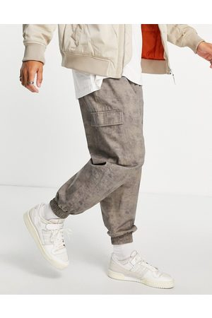 ASOS Oversized tapered pants with heavy wash