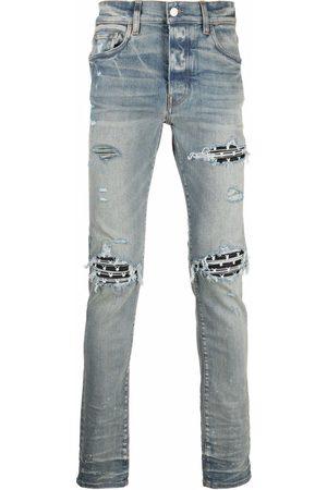 AMIRI Men Skinny - X Playboy ripped-effect skinny jeans