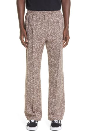 Pins & Needles Men's Butterfly Embroidered Leopard Jacquard Track Pants