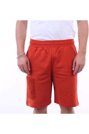 A-cold-wall* Shorts bermuda Men Rust