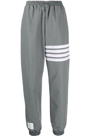 Thom Browne Women Sweatpants - 4-Bar Stripe shell track pants - Grey